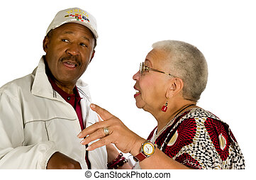 Gossip - A man and a woman gossiping about someone