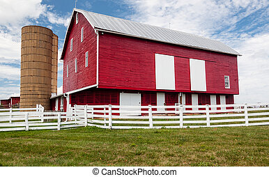 Traditional US red painted barn on farm - Red painted wooden...