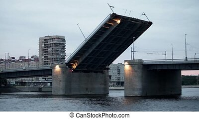 Drawbridge comes down - drawbridge in St Petersburg over the...
