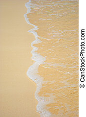 GENTLE FOAMY SURF ON THE BEACH - Gentle foamy surf lapping...