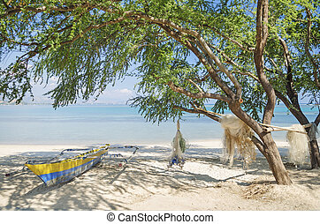 fishing boat on beach in dili east timor, timor leste