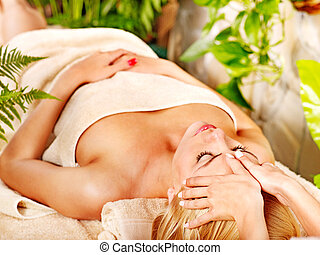 Woman getting facial massage . - Woman getting facial...