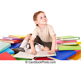 Child reading pile of books. - Little boy reading pile of...