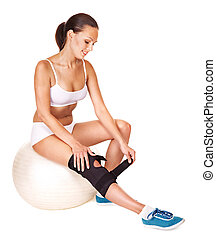 Woman with knee brace. Isolated.