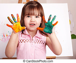 Kid making handprints with paint. - Little girl making...