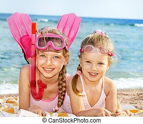 Children playing on  beach. Snorkeling.