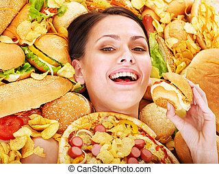 Woman eating hot dog - Thin woman holding hamburger