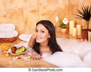 Woman relaxing in bath. - Woman relaxing in bubble bath .