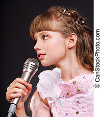 Singing of child in microphone. - Singing of little girl in...