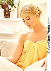 beautiful woman in spa salon with book - picture of...