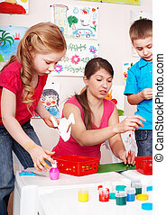 Child with teacher in play room.
