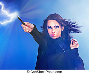 Young woman with magic wand - Young woman with magic wand...