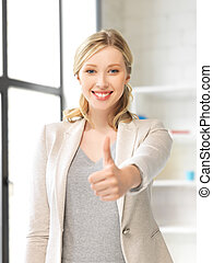 thumbs up - bright picture of young woman with thumbs up