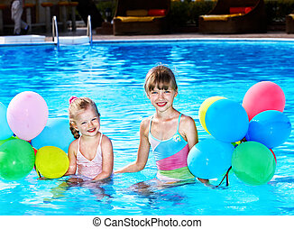 Children playing with balloons in swimming pool. - little...
