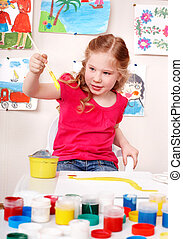 Child preschooler painting picture in play room. - Little...