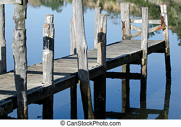 Empty wharf - An empty wharf pier on a calm river in New...