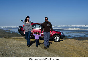 Family travels by four wheel drive vehicle on Ninety Mile...