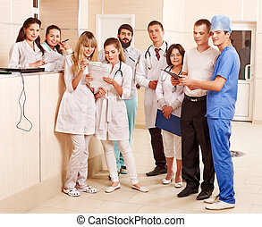 Group doctors at reception in hospital. - Group happy...