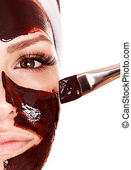 Girl having chocolate facial mask. - Girl having chocolate...