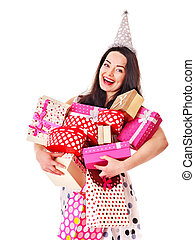 Woman holding gift box at birthday party - Young woman...