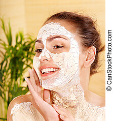 Woman with clay facial mask - Woman with clay facial mask in...