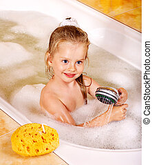 Child washing in bubble bath . - Happy child washing in...