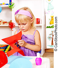 Child cutting out scissors paper - Child cutting out...