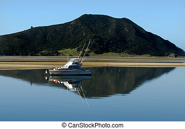 Luxury sport fishing boat against Mt Camel(Houhora Mountain)...