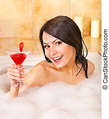 Woman washing in bubble bath - Young woman washing in bubble...