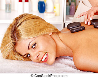 Woman getting massage - Blond woman getting massage in...