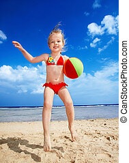 Children playing on beach. - Little girl playing on beach...