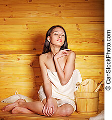 Girl in sauna - Young woman in sauna Healthy lifestyle