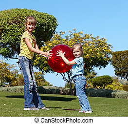Children playing in park.