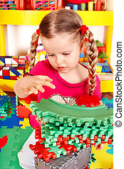 Child playing with building block . - Child preschooler...