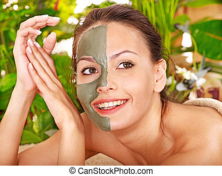 Woman getting facial massage - Woman getting facial mask in...