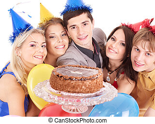 Group people holding cake. - Group people in party hat...
