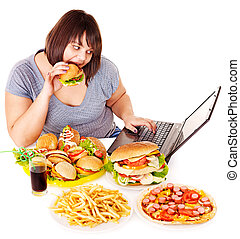 Woman eating junk food - Woman eating fast food at working...