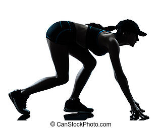 woman runner jogger on the starting block - one caucasian...