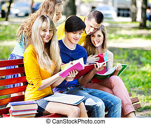Group student with notebook outdoor. - Group student with...