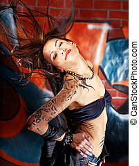 Girl with body art. - Woman with body art aganist graffiti...