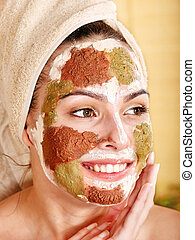 Woman with clay facial mask.