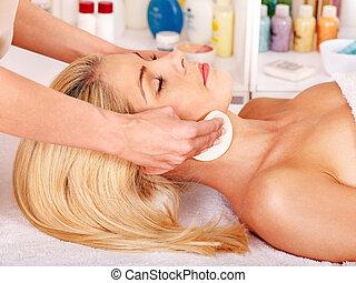 Woman getting facial massage . - Blond beautiful woman...