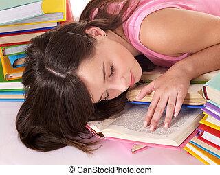 Girl sleep on pile of book.