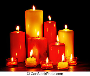 Group of  candles on  black background.