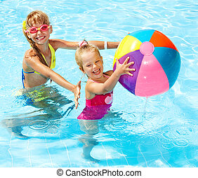 Children  swimming in pool. - Little girl  swimming in pool.