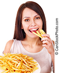 Woman eating french fries.