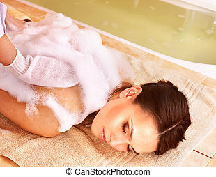 Massage of woman in beauty spa. - Young woman in hammam or...