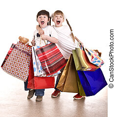 Boy and girl with shopping bag. Isolated.