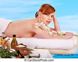 Woman getting spa treatment outdoor. - Young woman getting...
