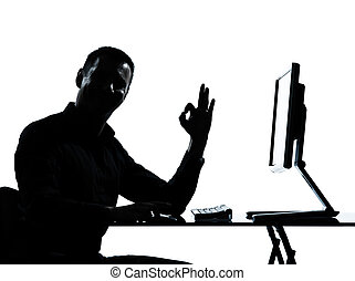 one business man silhouette computer computing ok gesture -...